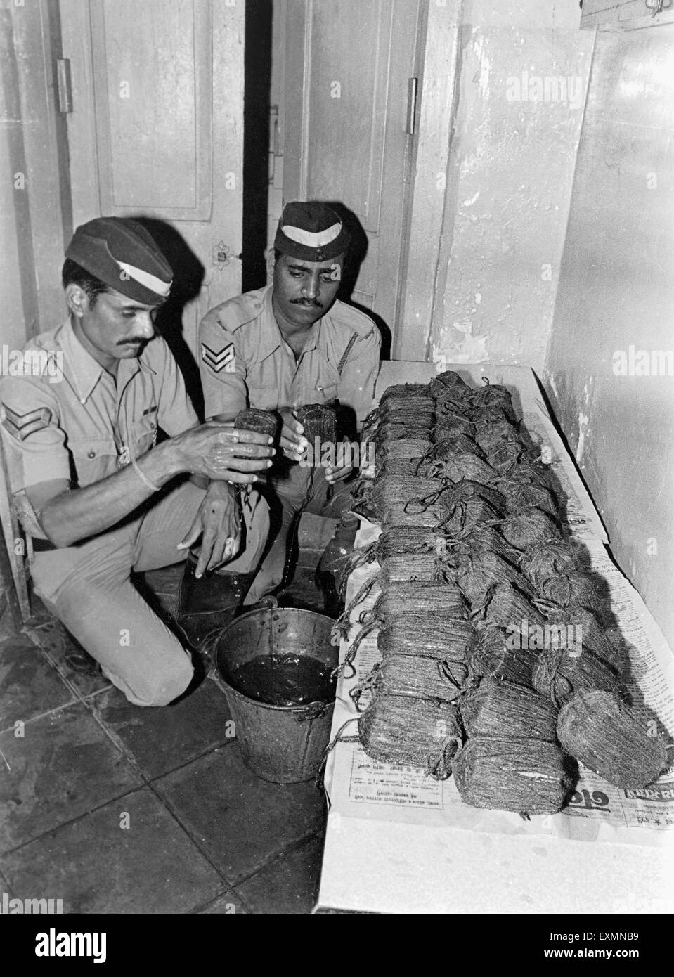 Policemen checking captured contraband goods Bombay Mumbai Maharashtra India - Stock Image