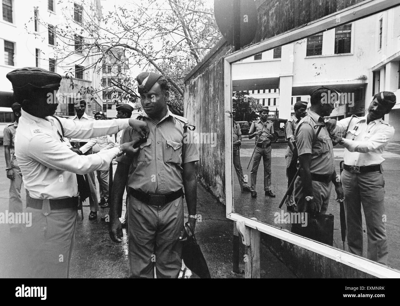 Police officer honor police man Bombay Mumbai Maharashtra India - Stock Image