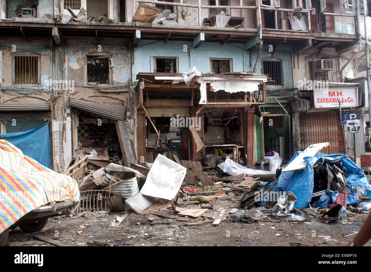 Shops damaged by powerful explosives bomb blast Zaveri Bazaar Kalbadevi Bombay Mumbai Maharashtra India - Stock Image