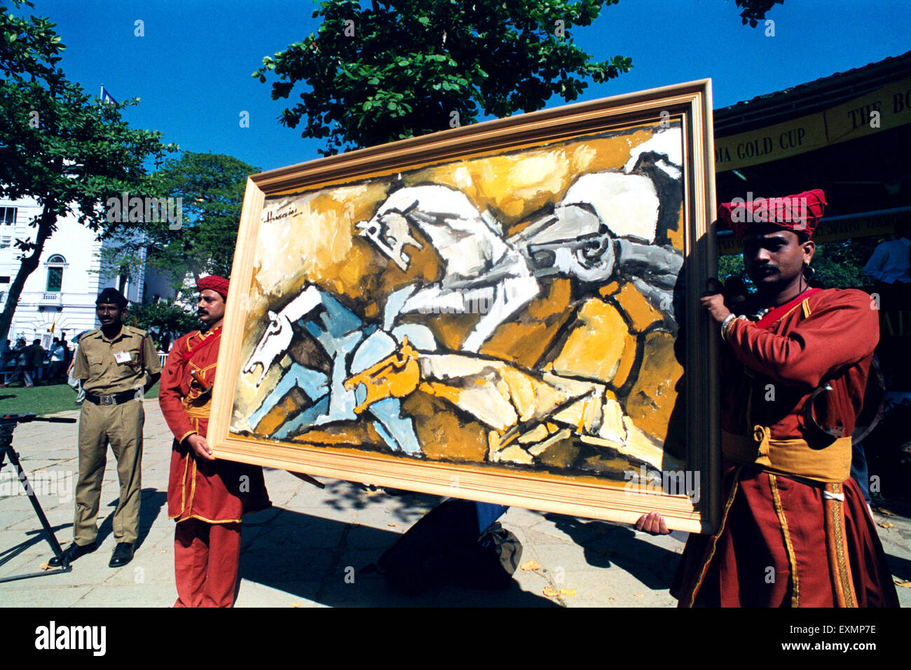 Maqbool Fida Husain MF Husain modern Indian painter of international acclaim painting for auction mahalaxmi race - Stock Image