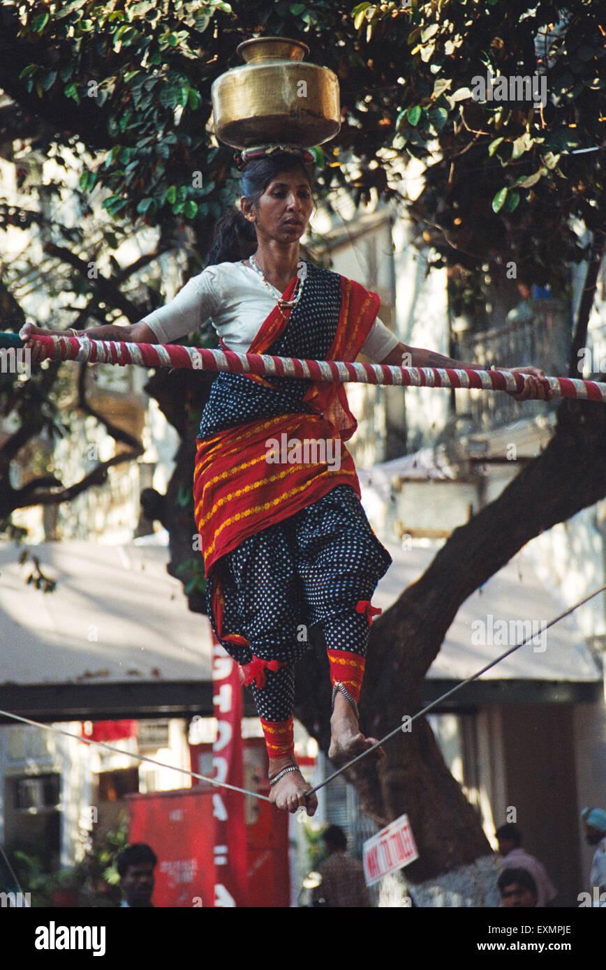 Woman balance rope pot kala ghoda fair Bombay Mumbai Maharashtra India Stock Photo