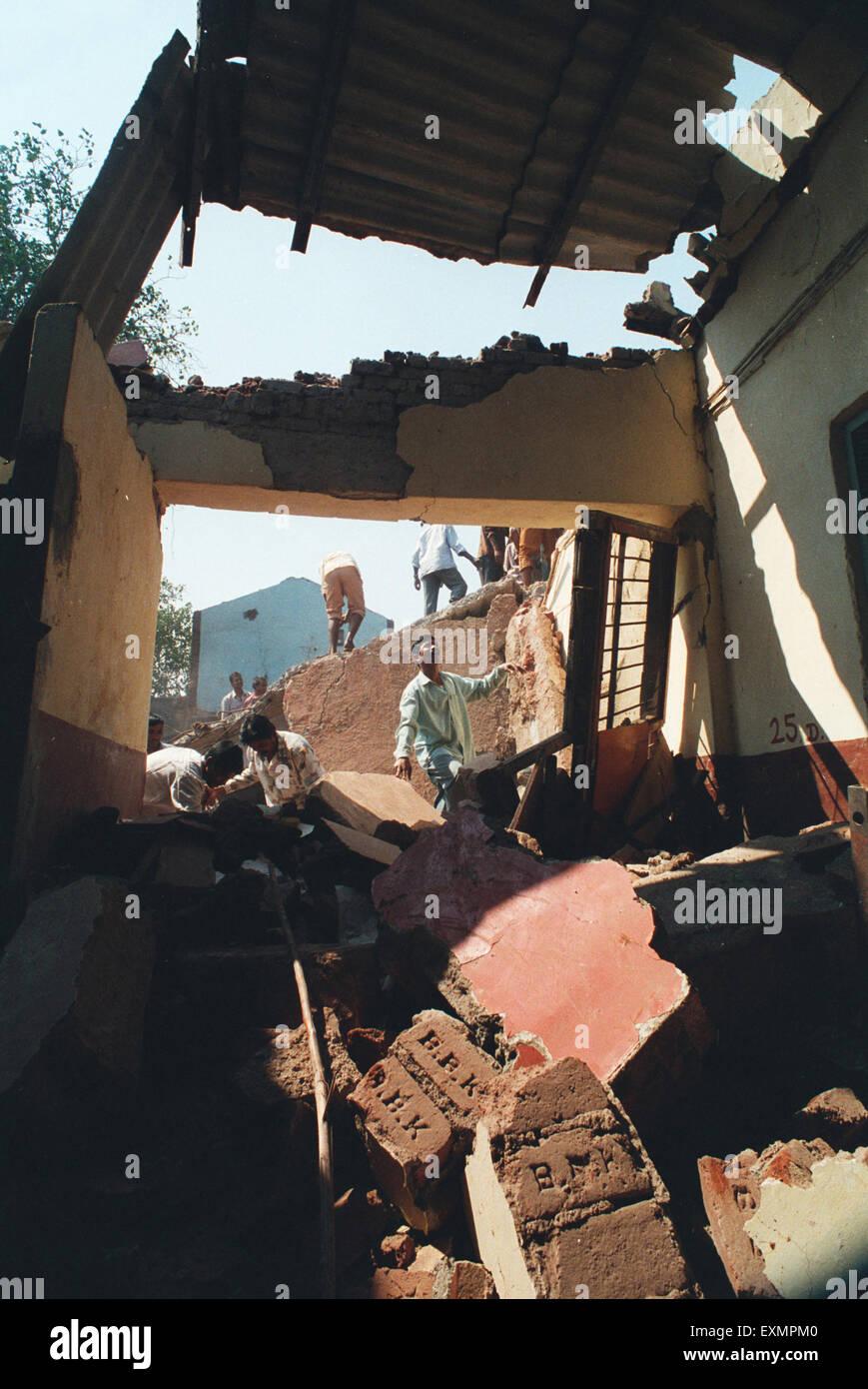 demolished broken destroyed illegal structure mumbai bombay maharashtra india - Stock Image