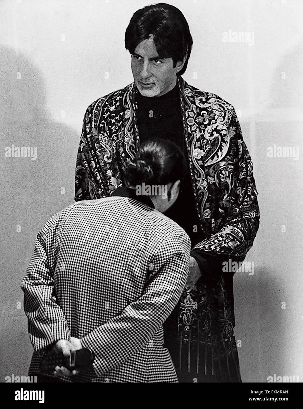 Wax figure Indian Bollywood actor Amitabh Bachchan being inspected by a tourist at Hotel la Meridian Mumbai India - Stock Image