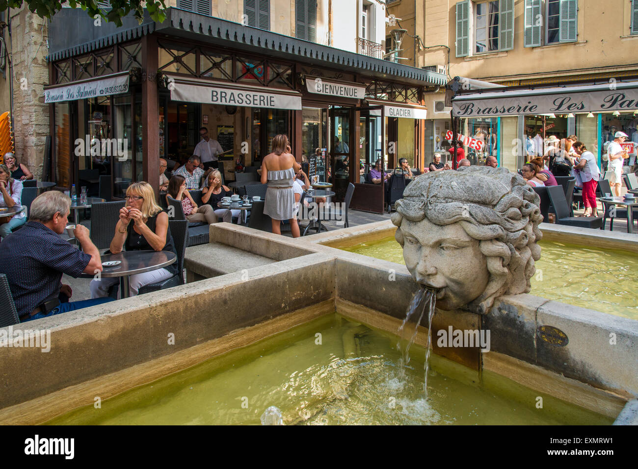 Brasserie cafe restaurant with people seated outside at tables, Carpentras, Provence, France - Stock Image
