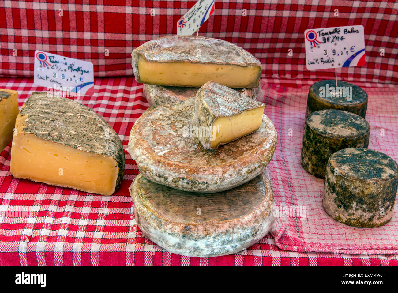 Local cheeses on sale at the market, Carpentras, Provence, France - Stock Image