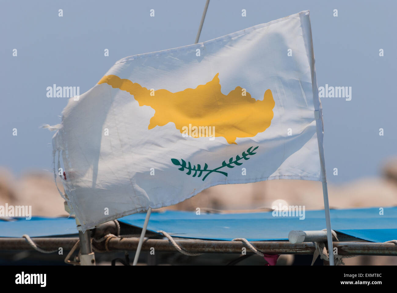 Flag of Cyprus on the wind with blue sky as a background - Stock Image
