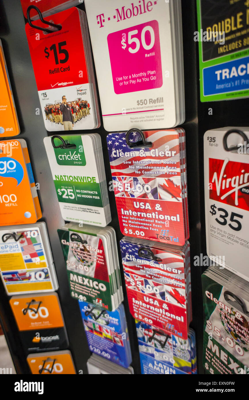 a display of international and domestic prepaid calling cards from various carriers in a store in - Prepaid International Calling Cards