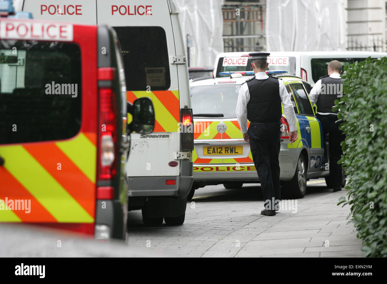 London, UK. 15th July, 2015. Police vehicles lined up outside the US Embassy  in W1A earlier today. Barriers were Stock Photo