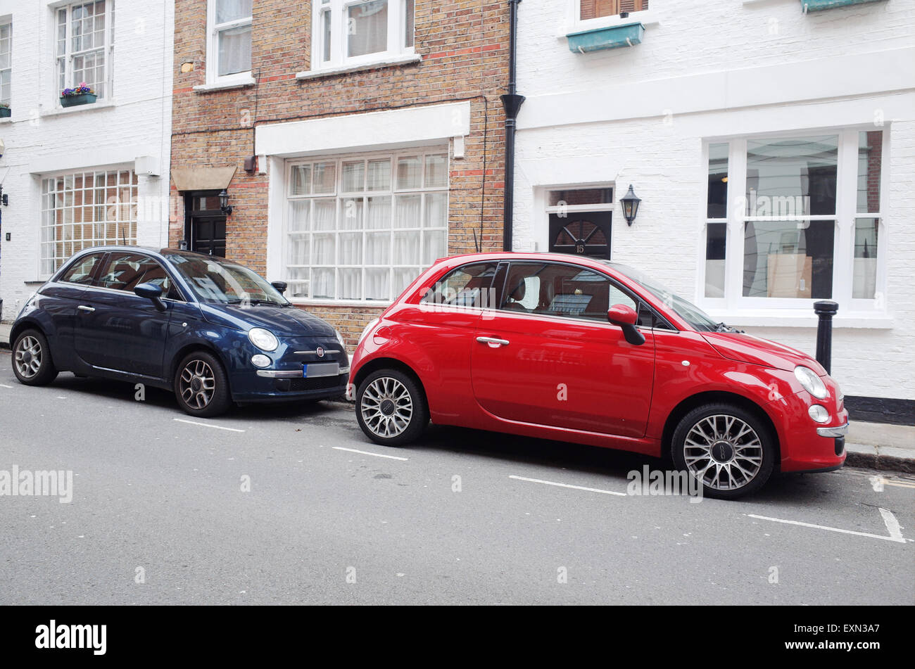 Red Fiat 500 car parked in London England 2015 - Stock Image