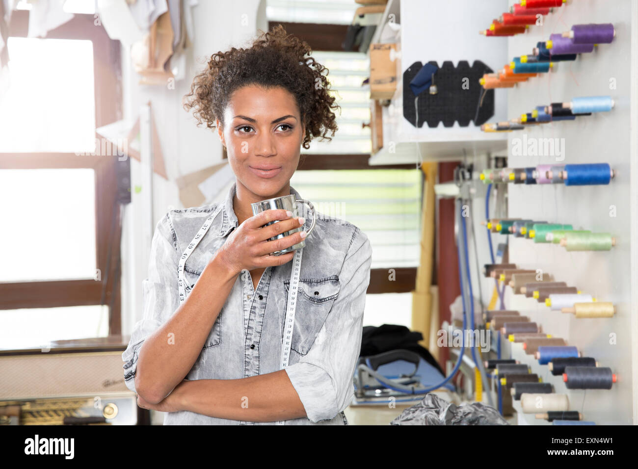 Young Fashion Designer Holding Coffee Cup Looking For Inspiration Stock Photo Alamy