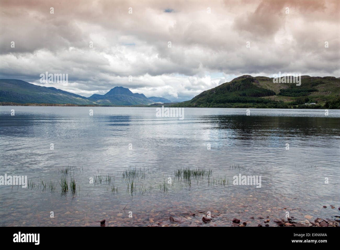 Loch Maree and Slioch under a stormy sky - Stock Image
