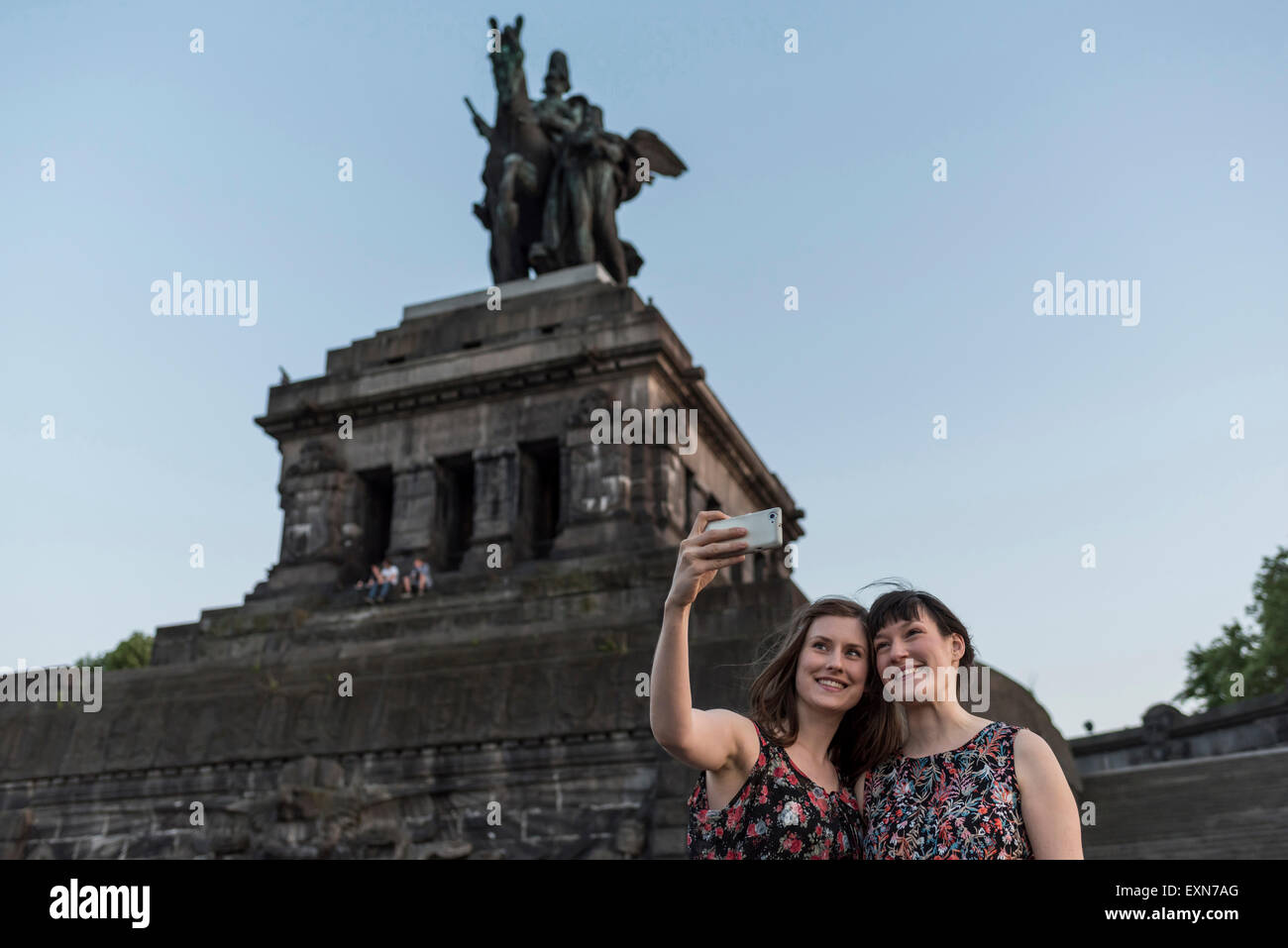 Germany, Koblenz, Deutsches Eck, tourists taking selfie at Emperor-Wilhelm monument - Stock Image