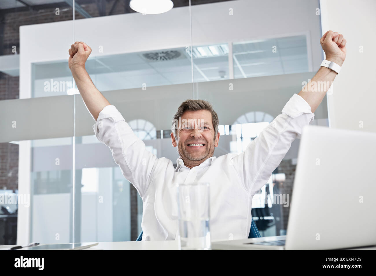 Enthusiastic businessman in office - Stock Image