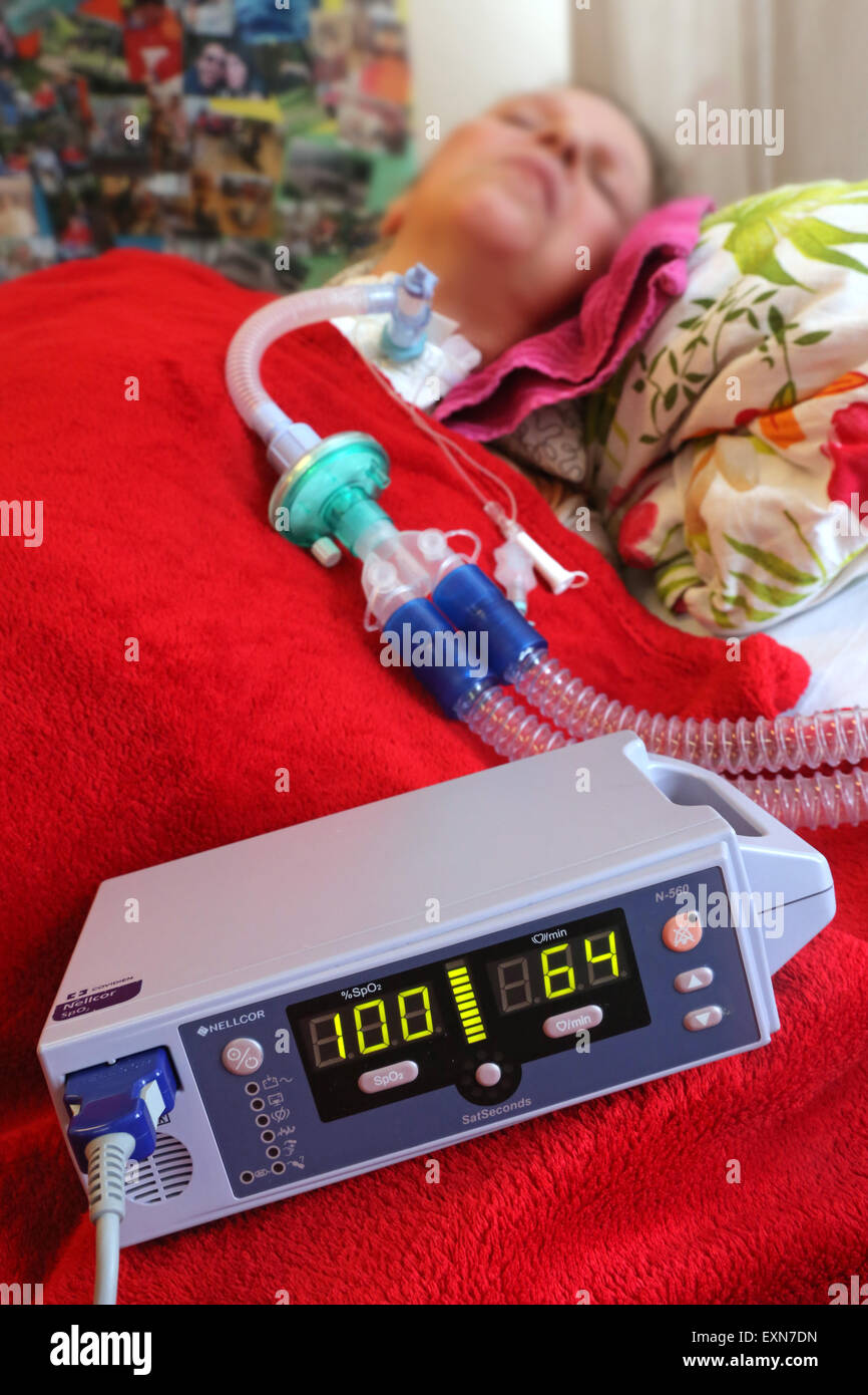 Patient who needs artificial respiration is monitored by a pulse oxymeter in a care center in Essen / Germany - Stock Image