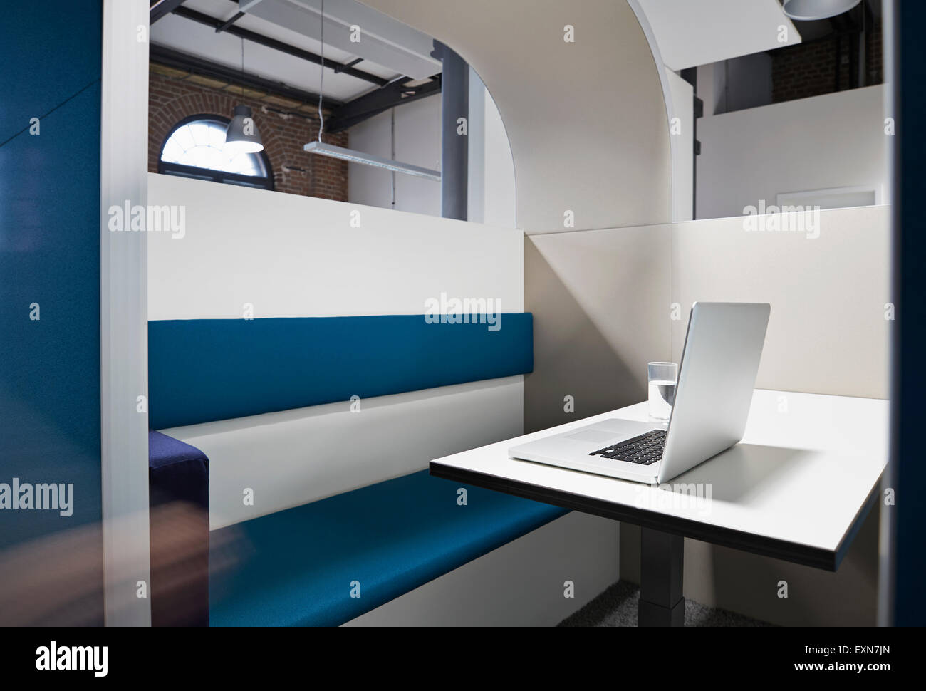 Modern office cubicle with noise protection partition wall - Stock Image