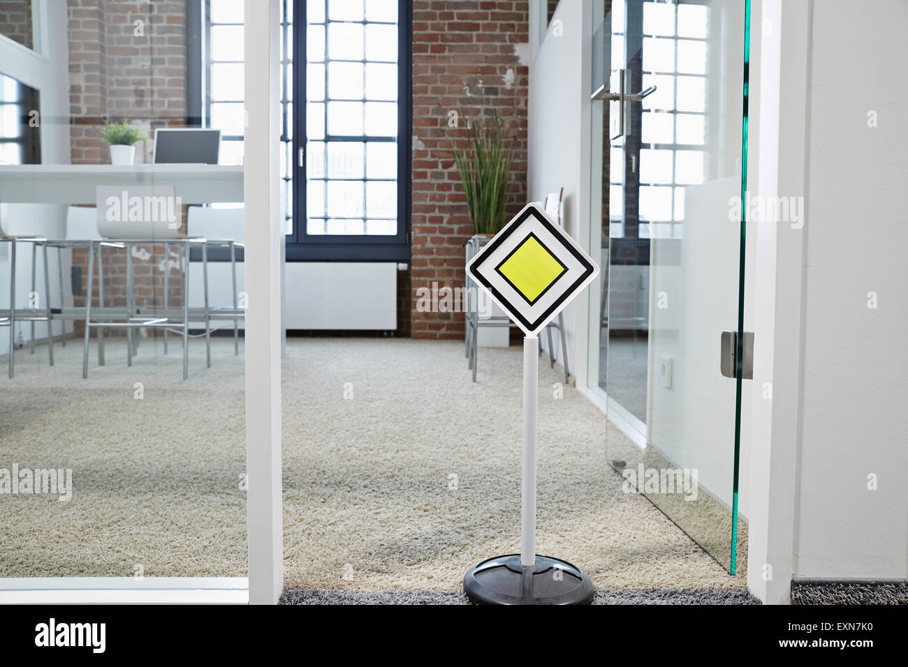 Right of way sign in modern open plan office - Stock Image