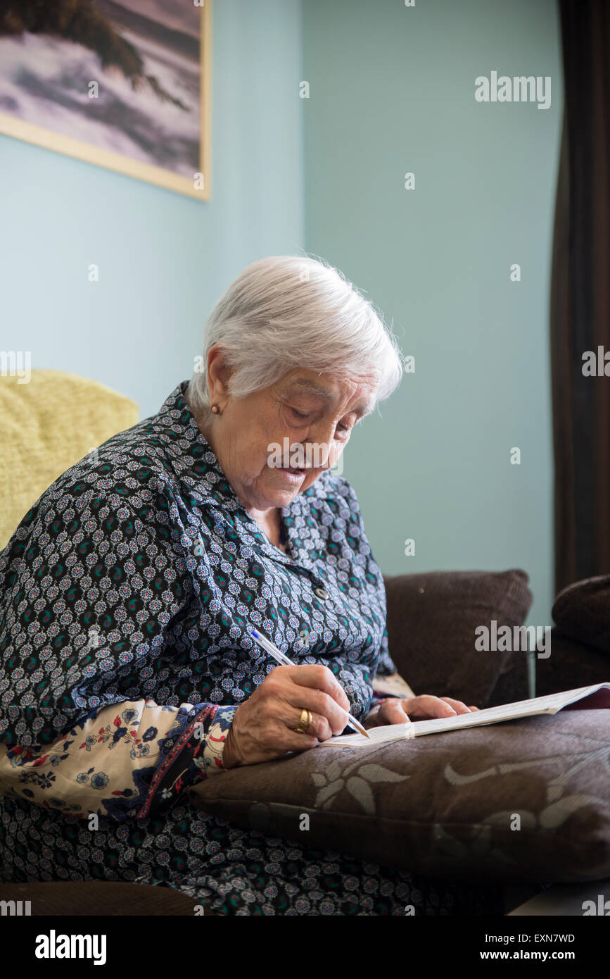 Old Woman Doing Crossword Stock Photos & Old Woman Doing Crossword ...