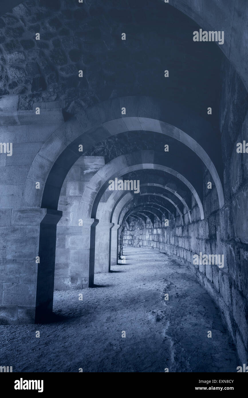 an old archway in the dark - Stock Image