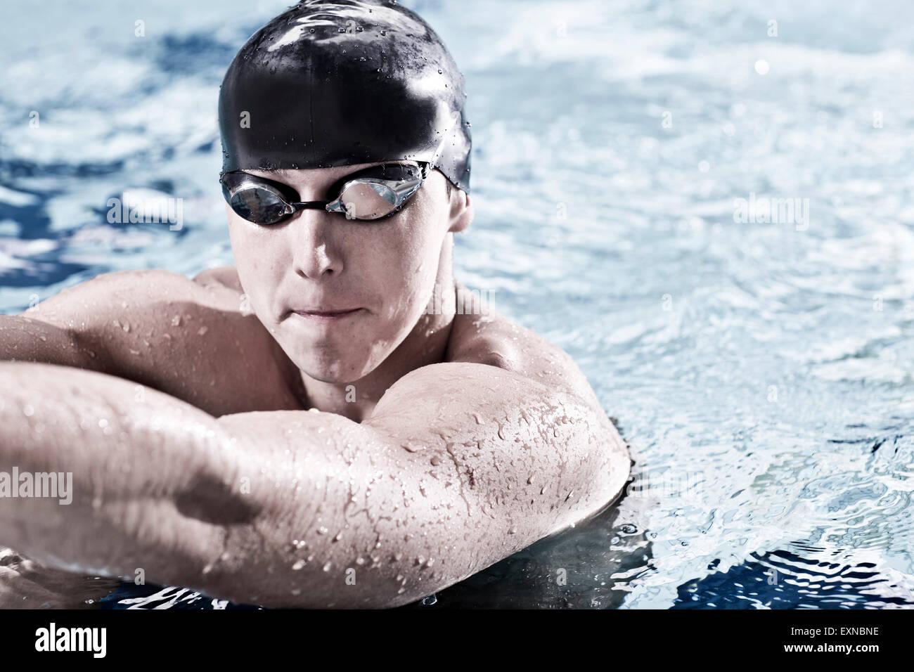 Swimmer in indoor pool - Stock Image