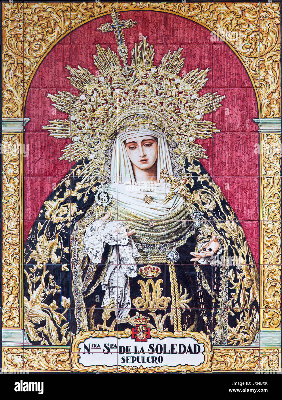 GRANADA, SPAIN - MAY 31, 2015: The ceramic tiled, cried Madonna on the facade of house on Calle Duque de la Victoria - Stock Image