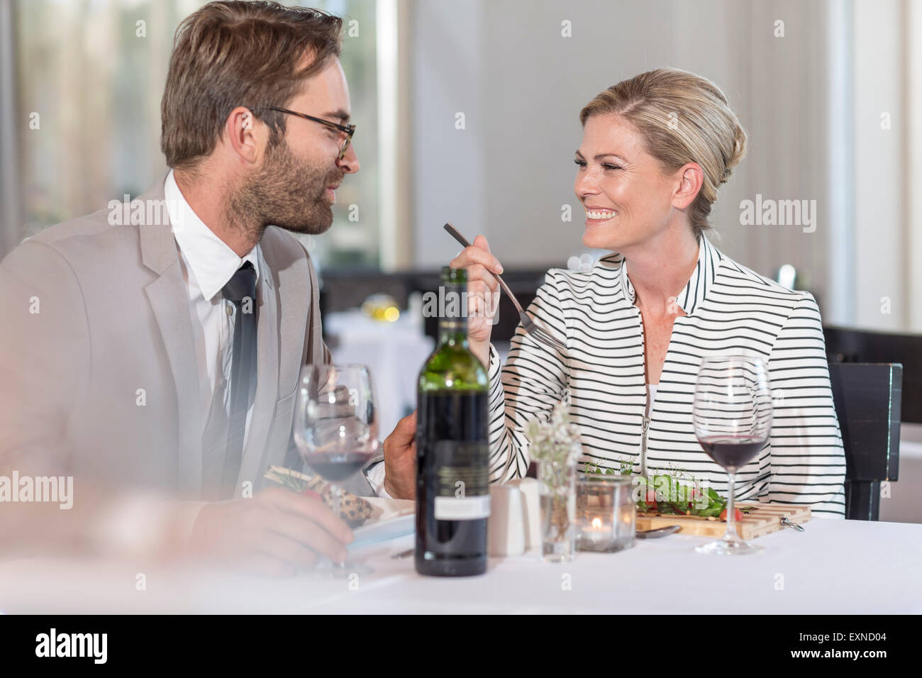 Happy couple having date in restaurant - Stock Image