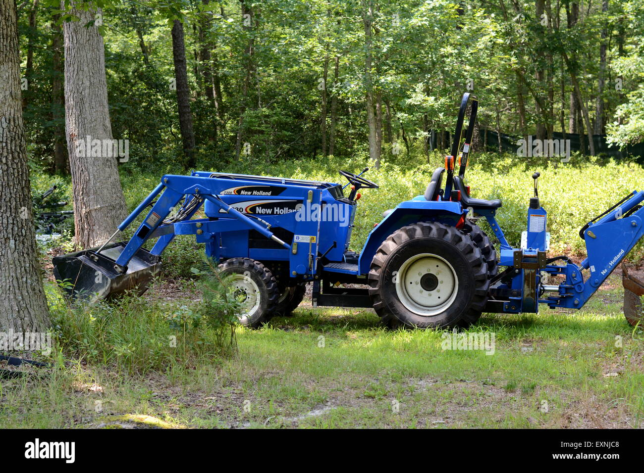 A Tractor for moving dirt and digging - Stock Image