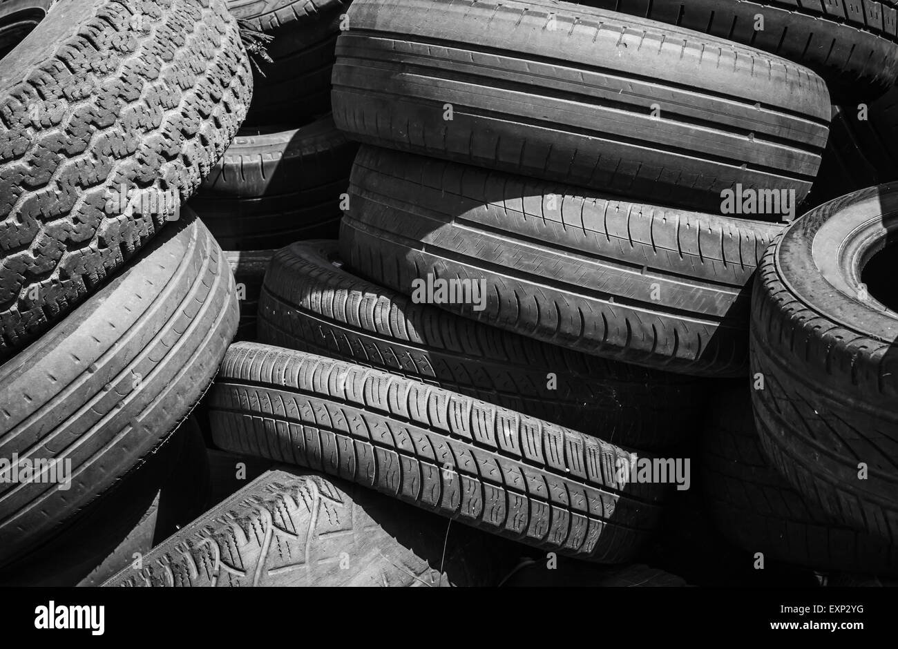 Heap of old used worn-out tires - Stock Image