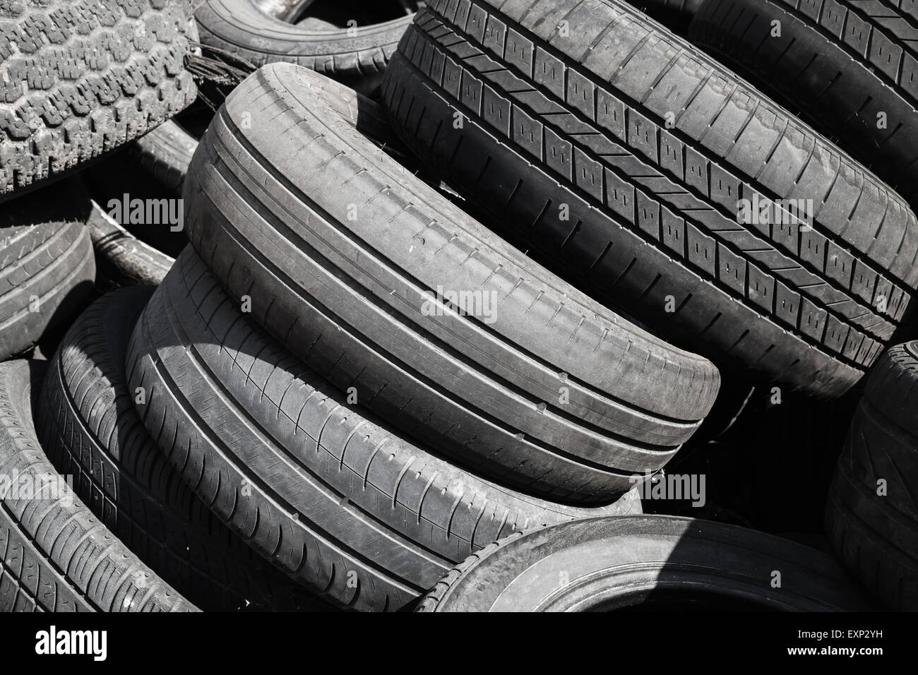 Heap of old used worn-out automotive tires - Stock Image