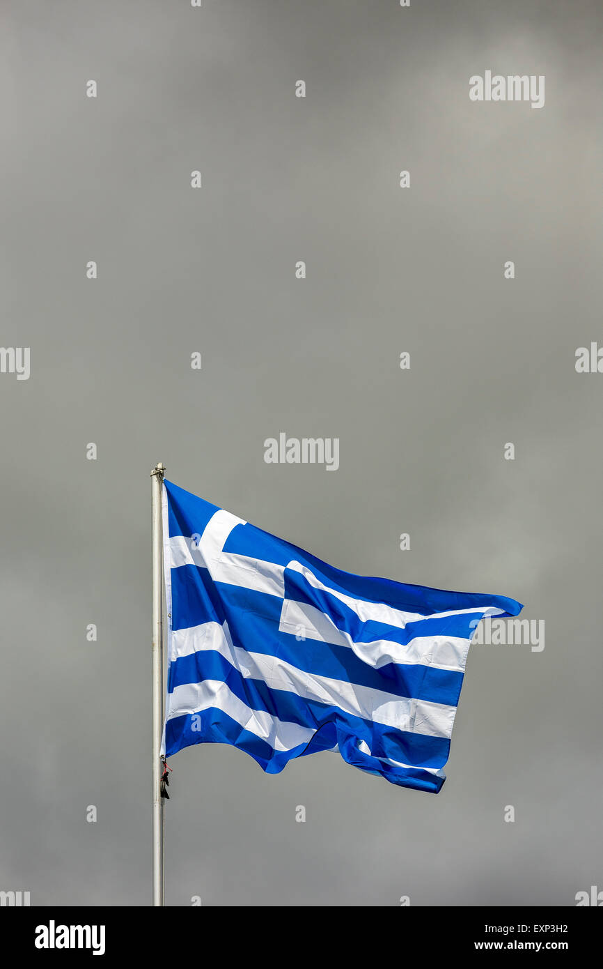 Flag of Greece, in front of clouded sky, waving in the wind - Stock Image