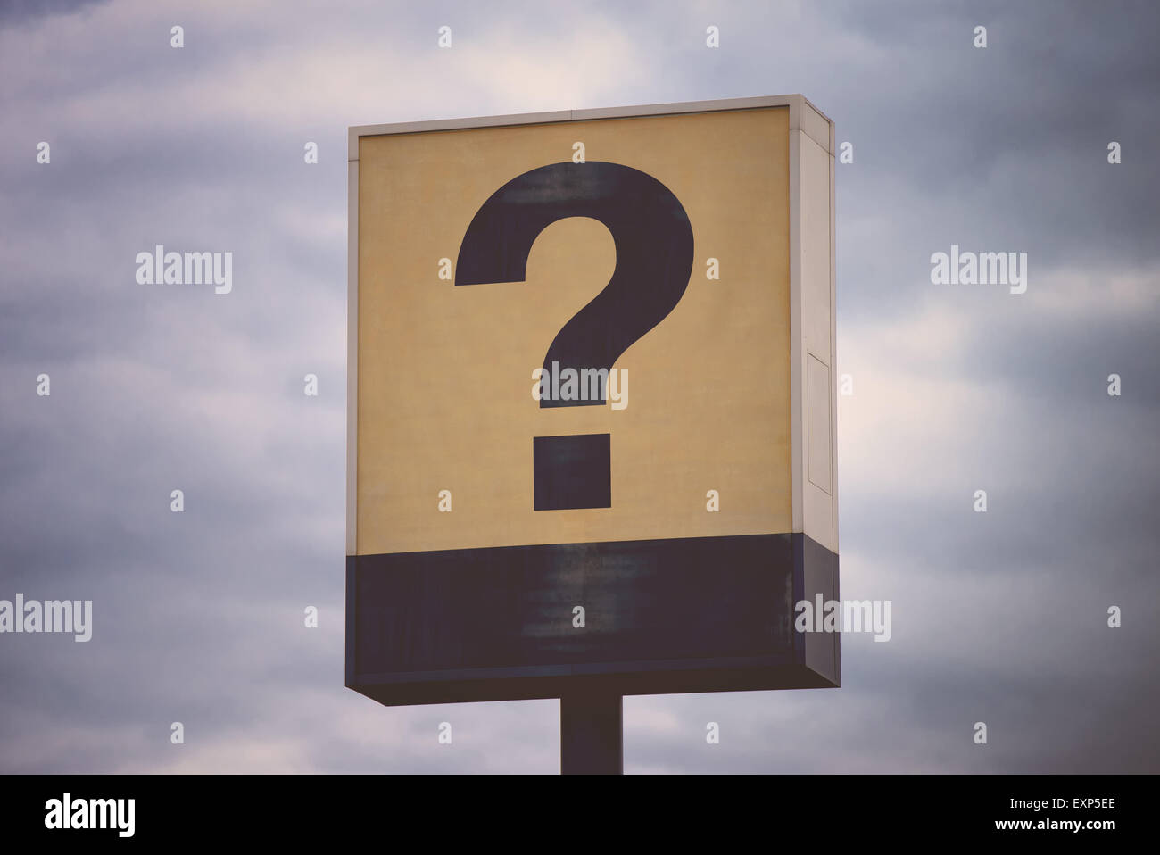 Question Mark on Vintage Sign, Retro Toned Cross Process Image - Stock Image