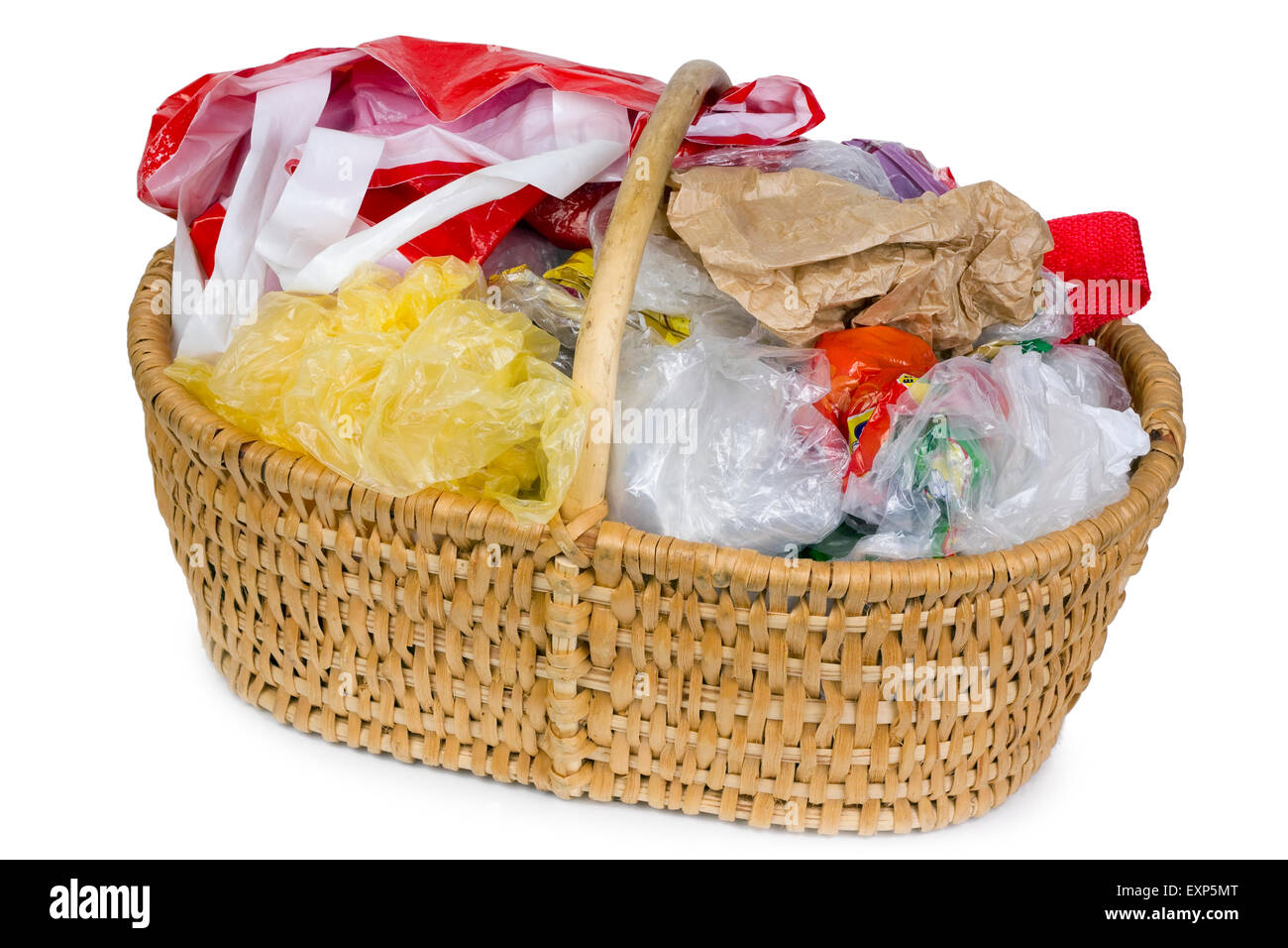 Wattled willow  basket with plastic old bags for packing of products. Isolated - Stock Image