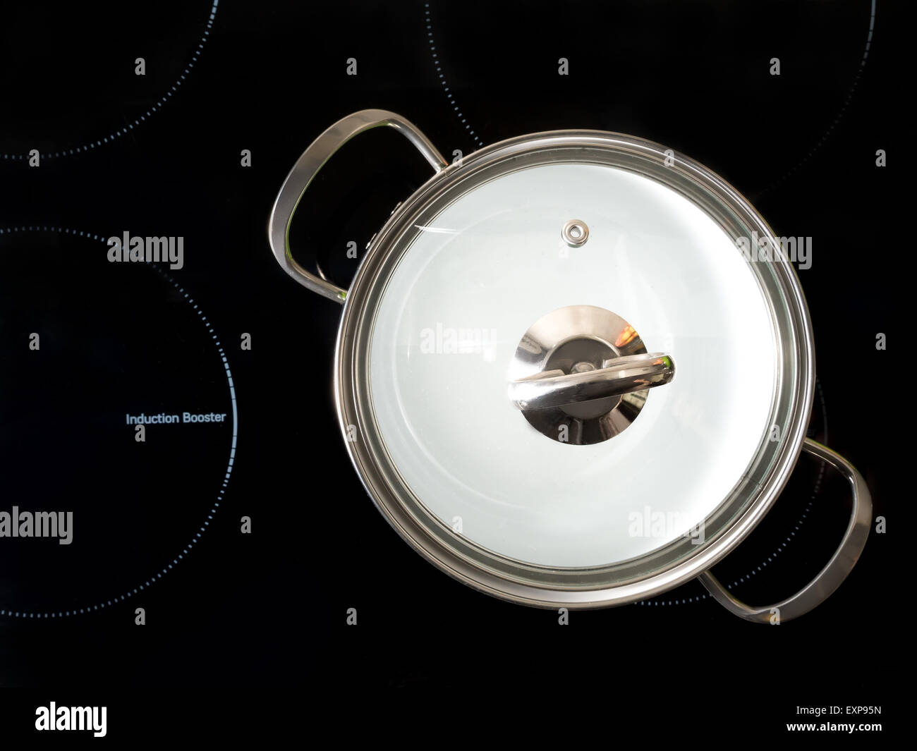 Stewpot on black induction cooker shot from above - Stock Image