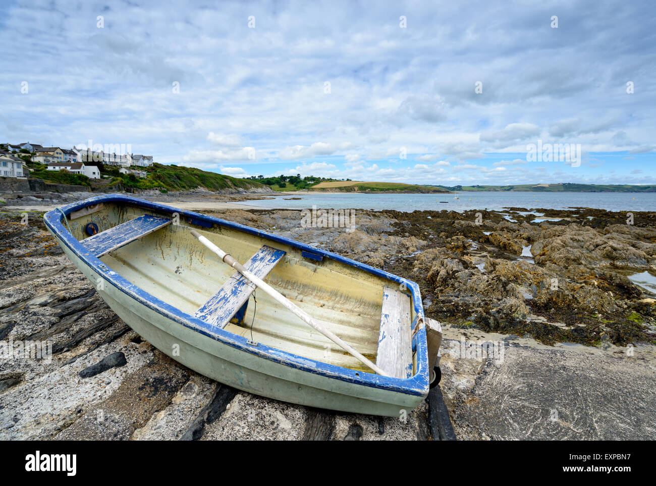 A dinghy on the beach at Portscatho a small picturesque fishing village near St Mawes on the Cornish coast Stock Photo