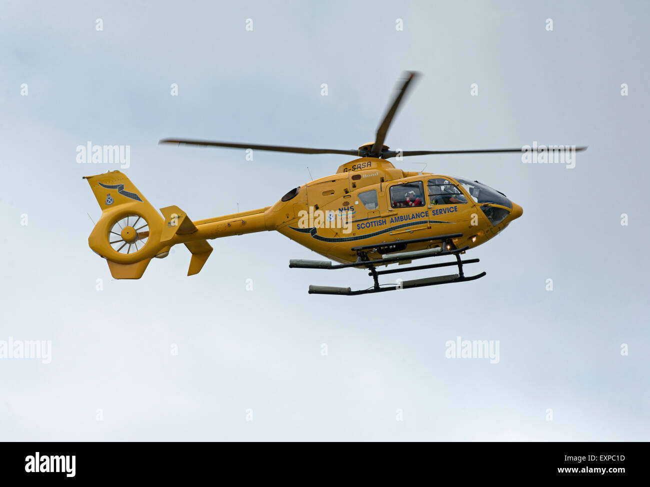 Eurocopter EC135T-1 G-SASA Departing Inverness Dalcross Airport Base on callout.  SCO 9959. - Stock Image