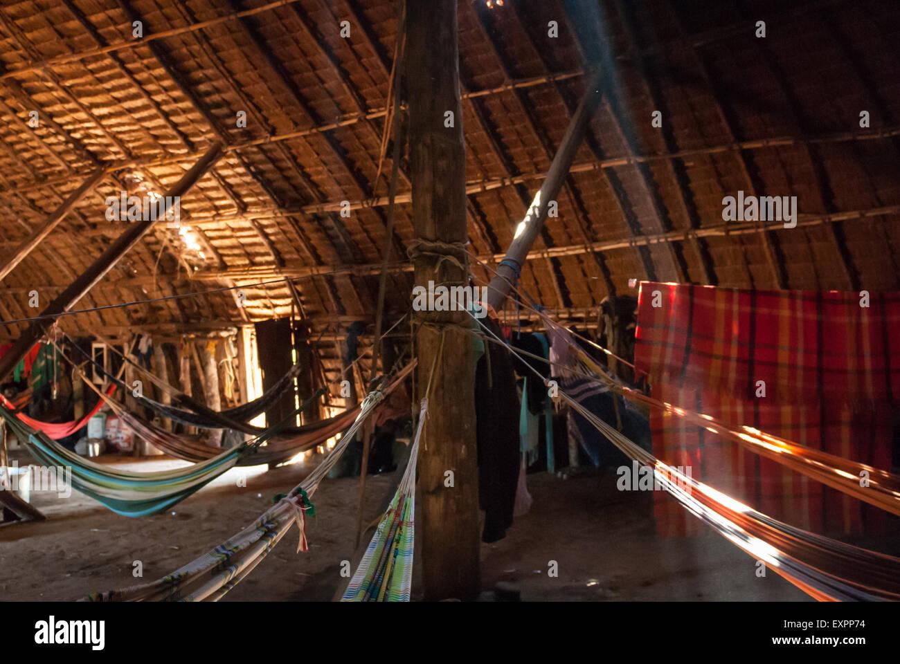 Xingu Indigenous Park, Mato Grosso, Brazil. Aldeia Matipu. Guest hammocks in traditional Oca house. - Stock Image