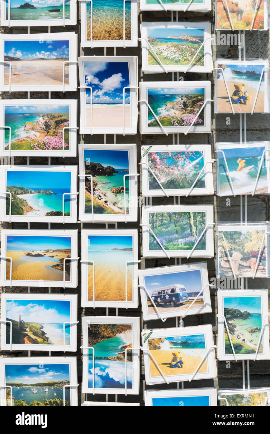 Souvenir postcards on sale in a rack in Padstow Cornwall UK - Stock Image