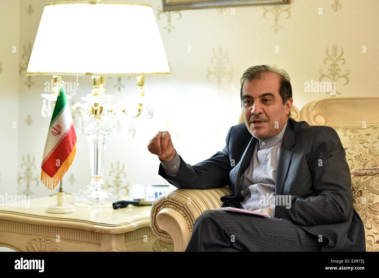 Beijing, China. 16th July, 2015. Iranian ambassador to China Ali Asghar Khaji speaks during an interview in Beijing, - Stock Image