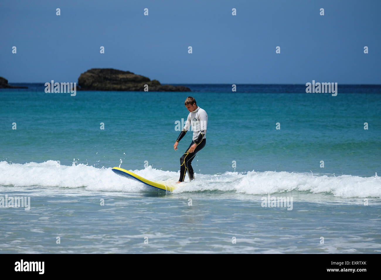 St Ives, Cornwall, UK: Surf School Instructor on Porthmeor Beach - Stock Image