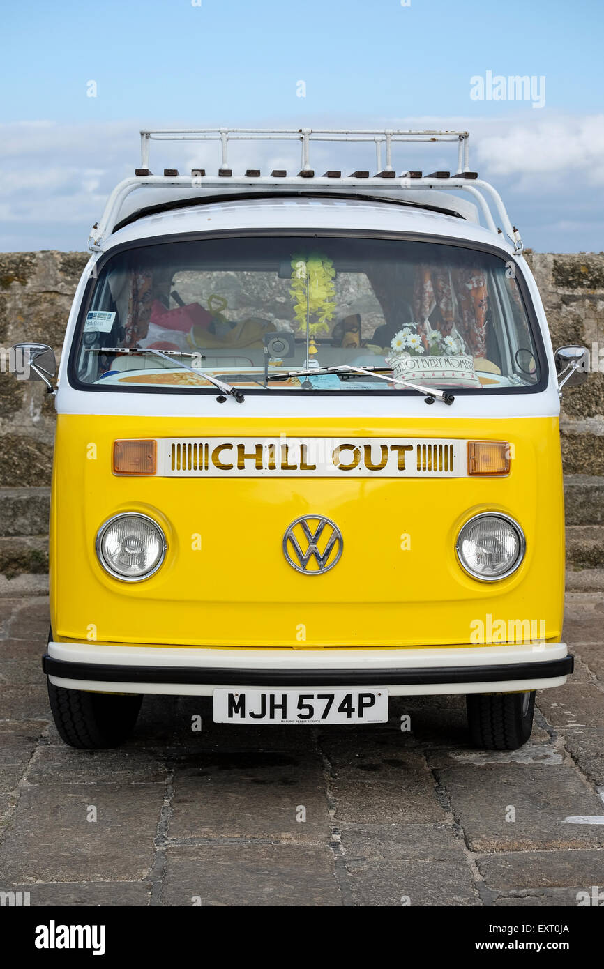St Ives, Cornwall, UK: Yellow VW Camper van with 'Chill Out' sign on front, parked in St Ives, Cornwall. - Stock Image