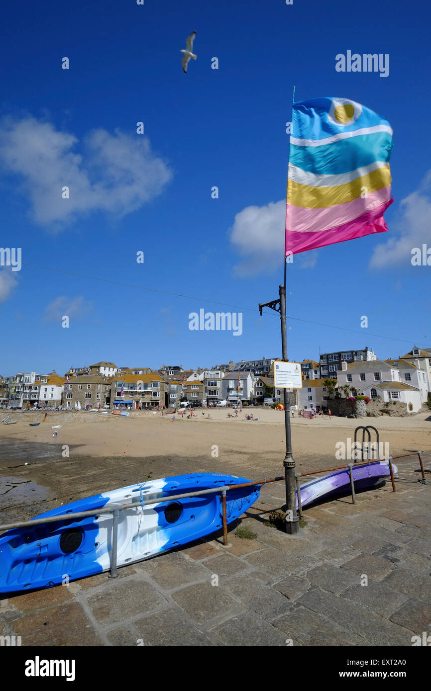 St Ives, Cornwall, UK: Brightly colored Flag flying on Smeaton's Pier in St Ives being trialled as a Seagull - Stock Image