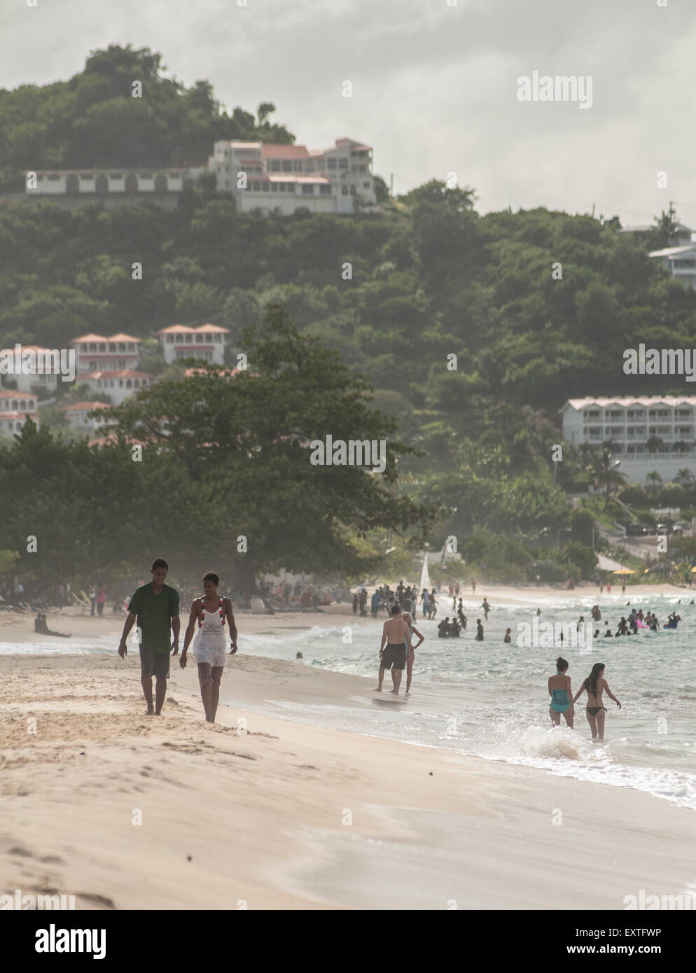 A couple walk together on Spinnakers beach, Grenada in the Caribbean     Credit: Euan Cherry - Stock Image