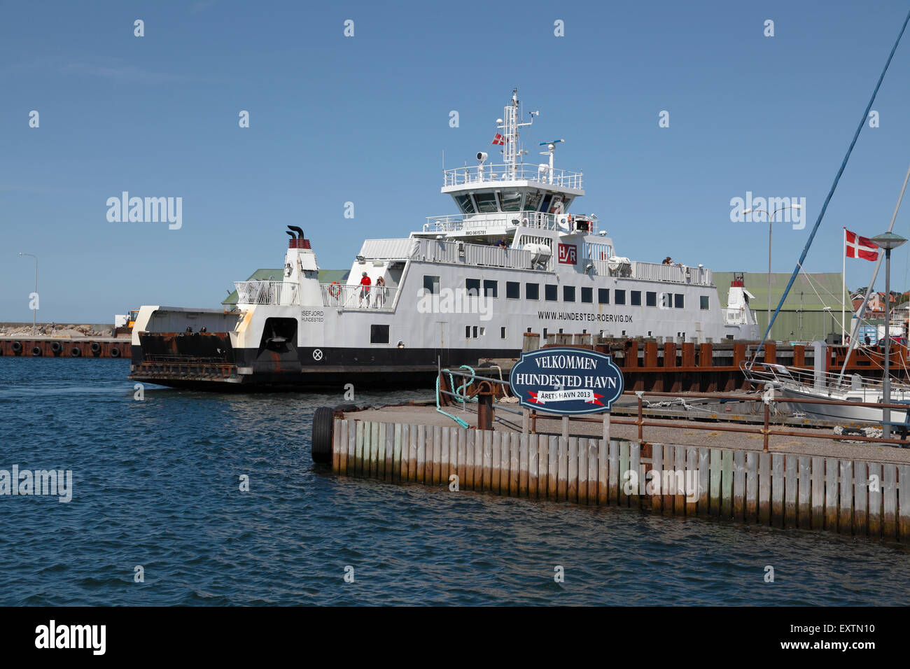 The small ferry ISEFJORD enters Hundested Harbour ferry berth after the short journey across the mouth of the inlet - Stock Image