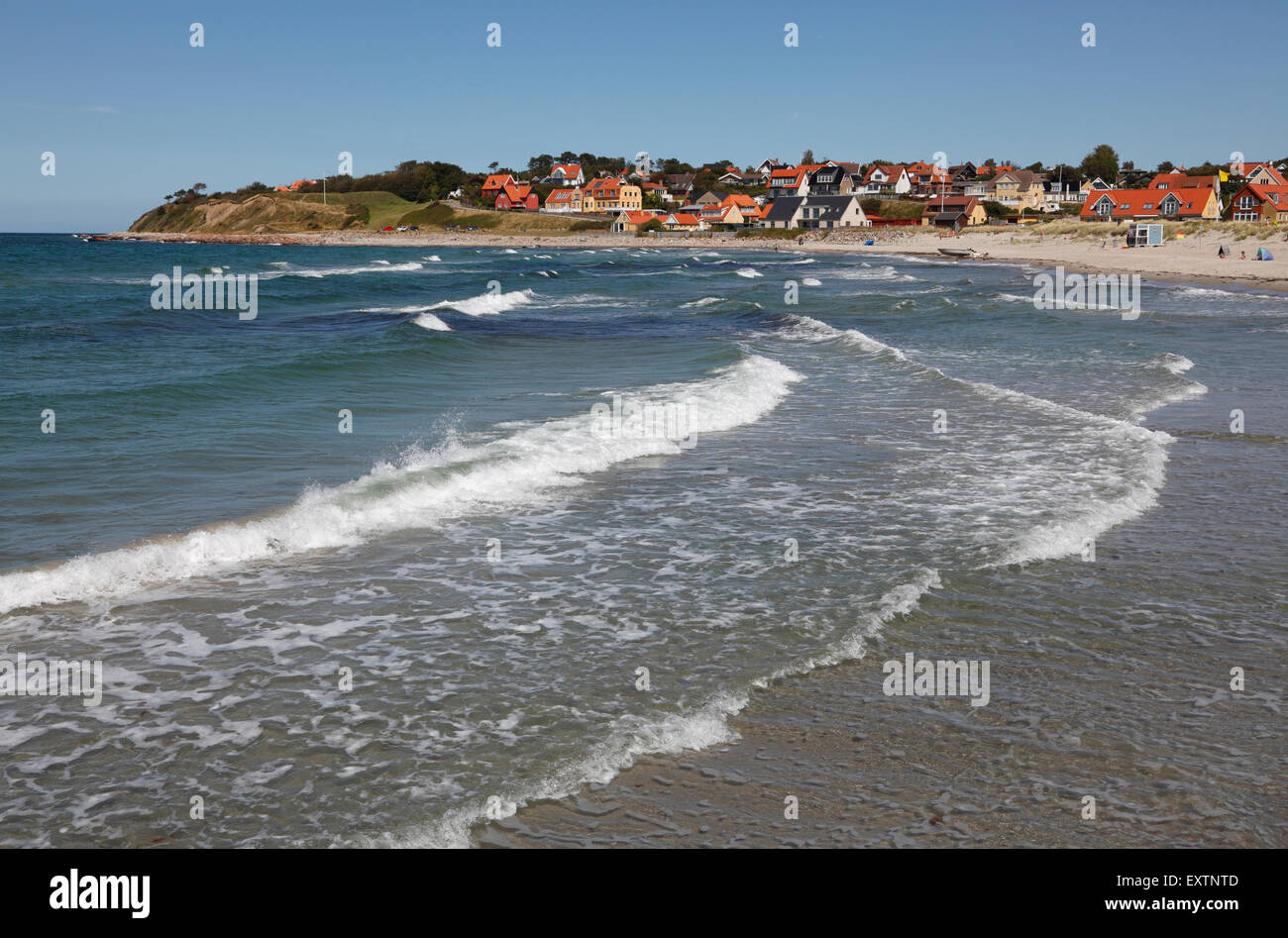 Surf at Hundested Beach on a summer's day, to the left the lower part of the 30 m tall cliff Spodsbjerg also - Stock Image