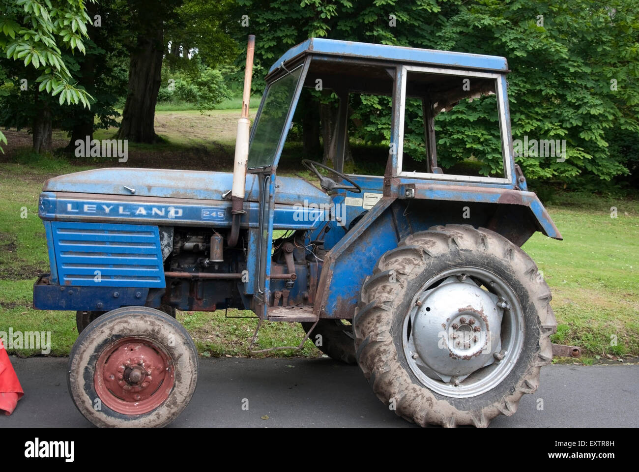 A Working Two tone Blue 1970's Leyland 245 Tractor - Stock Image