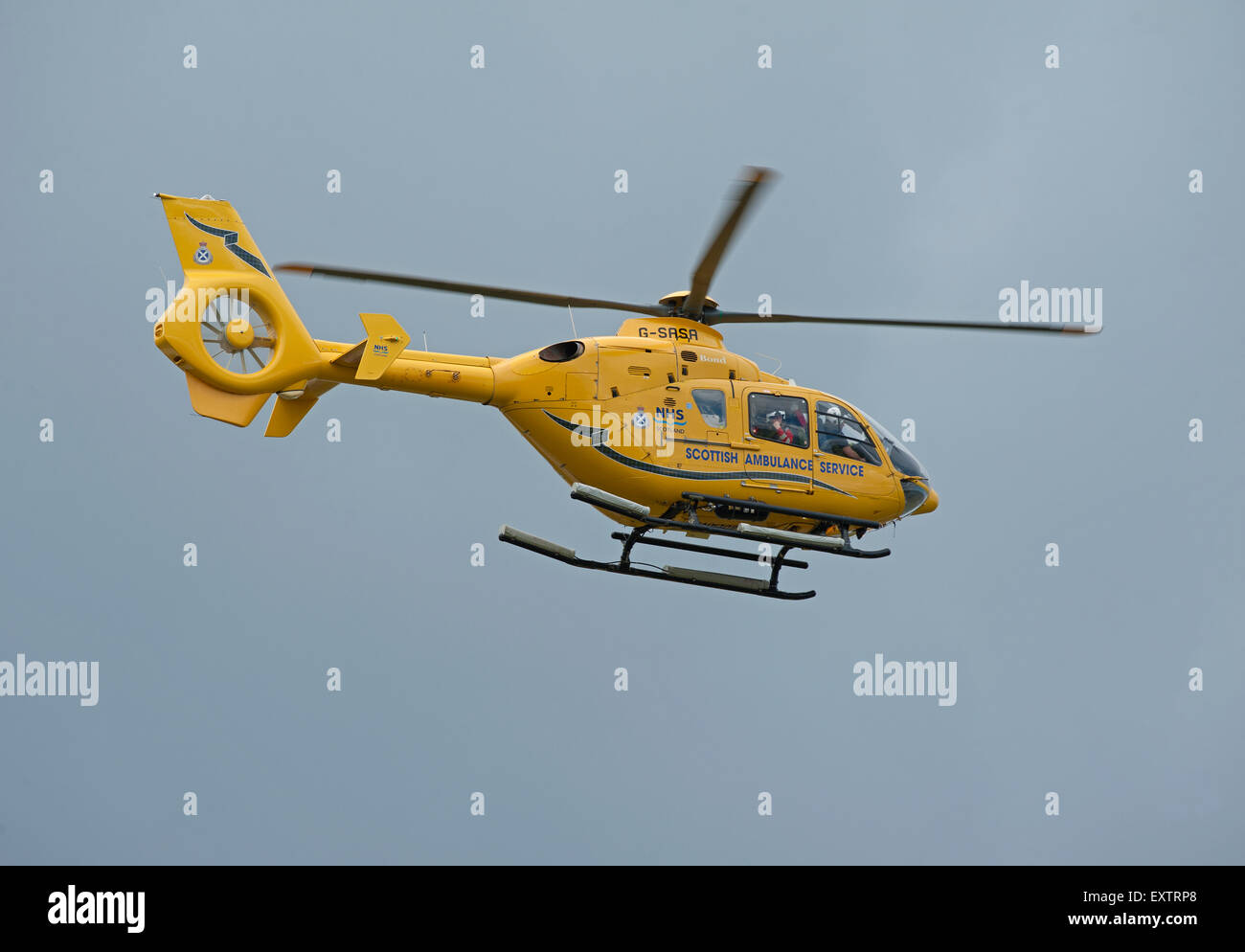 Eurocopter EC135T-1 G-SASA Departing Inverness Dalcross Airport Base on callout.  SCO 9960. - Stock Image
