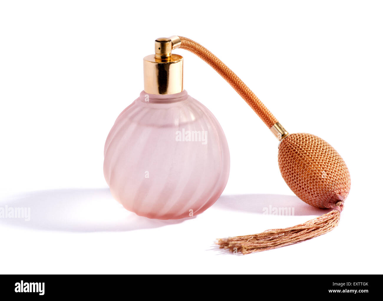 Swirling decorative glass pink perfume bottle - Stock Image