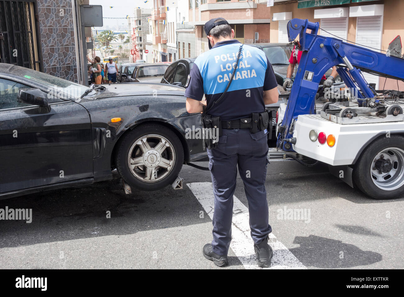 illegally parked car being towed away by Police in Canary Islands - Stock Image