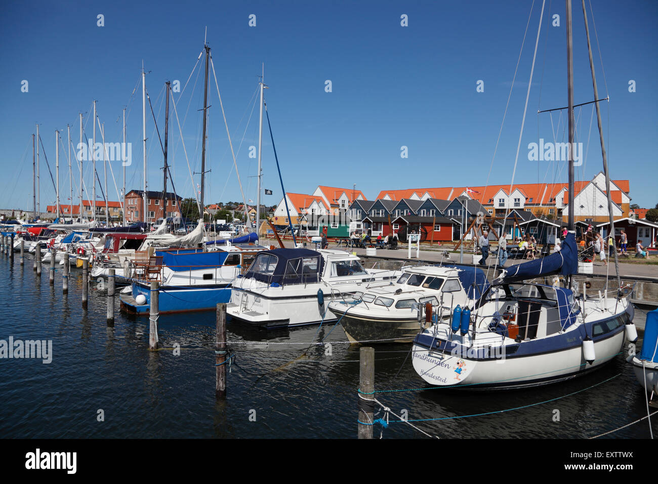 The marina in Hundested Harbour on a sunny summer's day with a blue sky - Stock Image