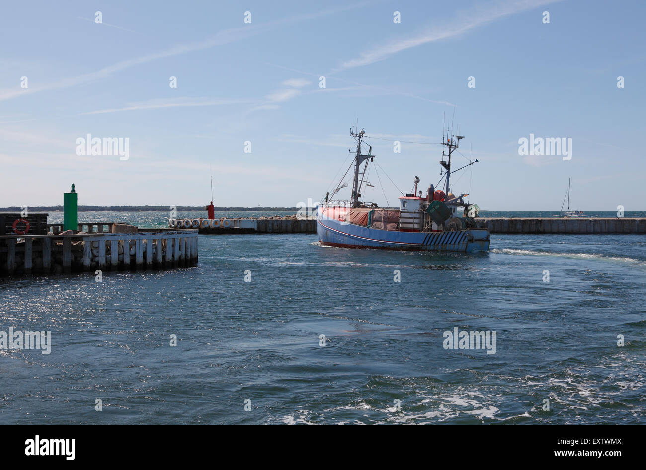 Fishing vessel leaving Hundested Harbour, an old fishing port in North Zealand in the southern part of the Kattegat - Stock Image