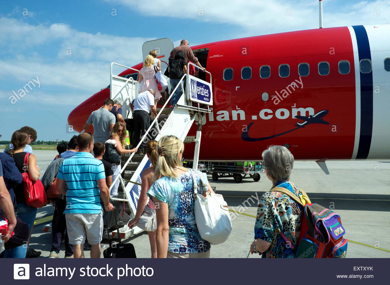 Airline passengers boarding a Norwegian (a low cost airline) service, on a Budapest to London Gatwick flight. July - Stock Image